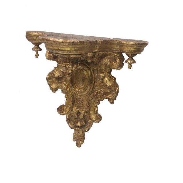 A very beautiful 18th century heavily carved gilt bracket from Italy.