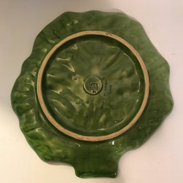 Large ceramic lettuce ware platter with green and white glazed finish.