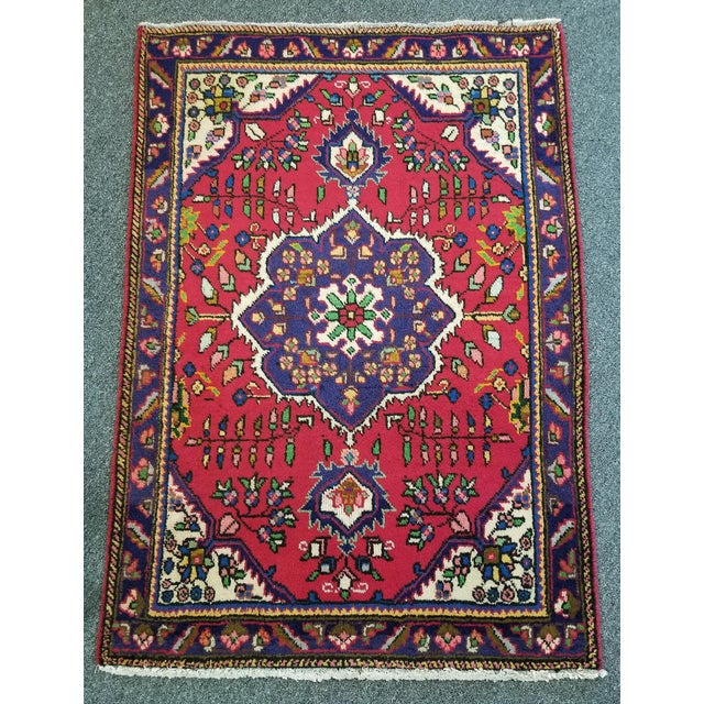 This is a TABRIZ Persian carpet from the 1950s. This rug showcases a beautiful floral border, vibrant colors, and...