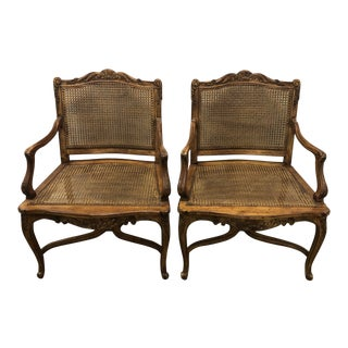 1970s Vintage Regence Cane French Carved Arm Chairs- a Pair For Sale
