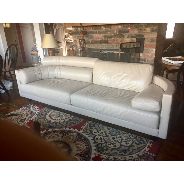 This stylish and comfortable soft buttery Italian leather sofa features a rounded back with 6 geometrically shaped...