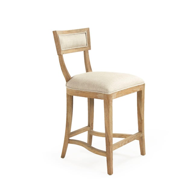 Curved back counter stool upholstered in natural cream linen on limed grey oak legs.