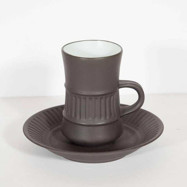 A Mid-Century flamestone dessert and coffee or tea service in earthenware with glazed interior, designed by Jens Harald...