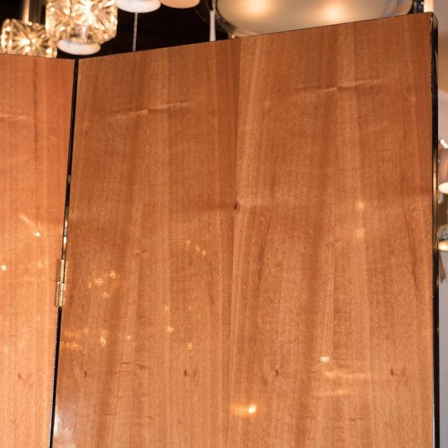 An Art Deco cubist style four-panel folding screen or room divider. The four panels are exotic burled carpathian elm with...