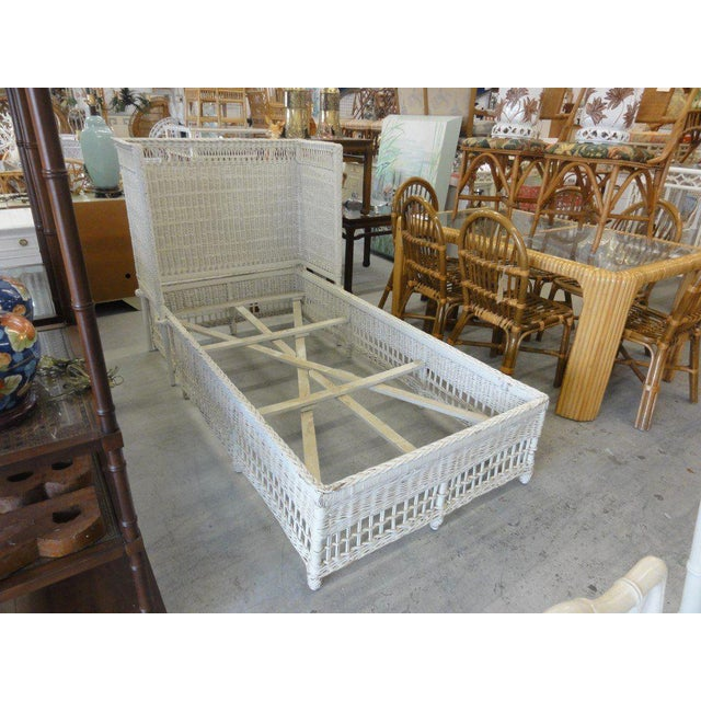 Charming hooded wicker twin bed. Made in the late 20th century.