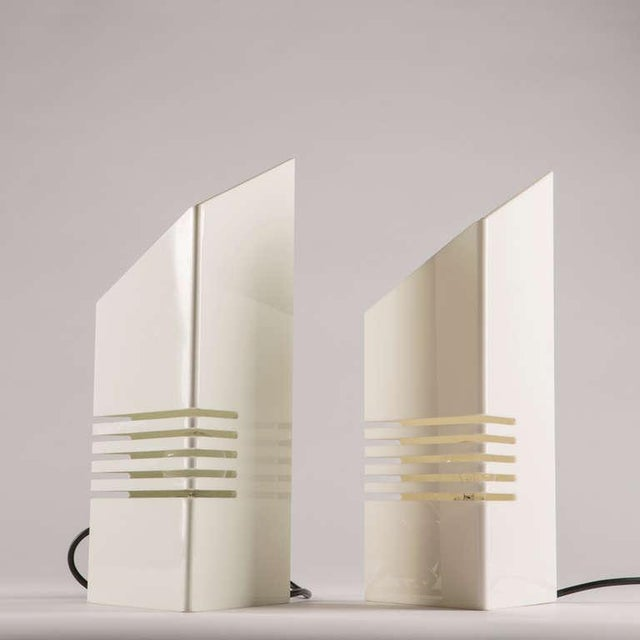 """Rare set of two """"Personaggi"""" table lamps by Carmellini and Tronconi. A white plexiglass bended sheet with cuts compose..."""