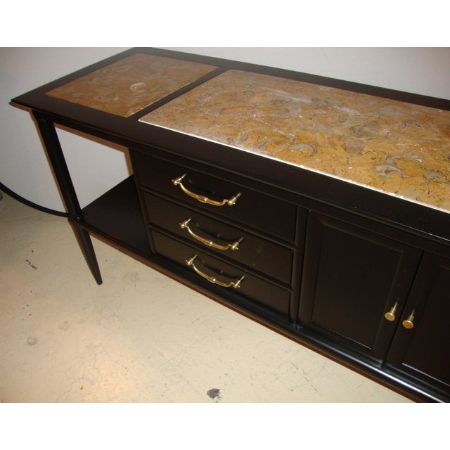 This is a pair of Tomlinson stamped marble-top ebonized credenzas or console tables. Each is of custom quality and both...