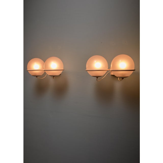 A pair of model '237-2' wall lamps, designed by Gino Sarfatti for Arteluce in 1959. The lamps are made of a rare white...