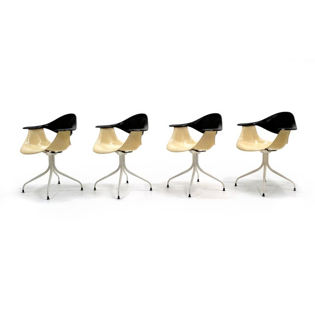 "Fine and rare set of four George Nelson & Associates Model DAF chairs commonly referred to as ""Swag Leg"" chairs...."