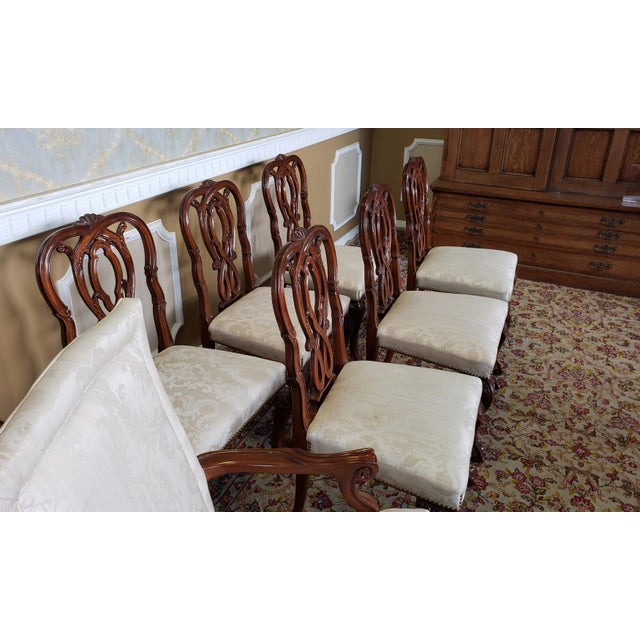 Description: This is a very fine set of 8 high end formal Chippendale style dining room chairs made by Karges Furniture....