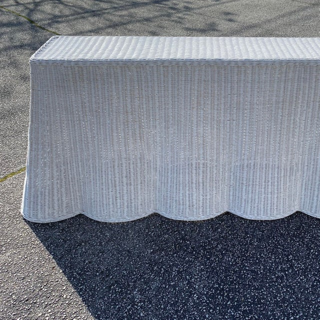 """Natural rattan console skirt table in white lacquer finish Top surface dimension 67""""x12"""""""