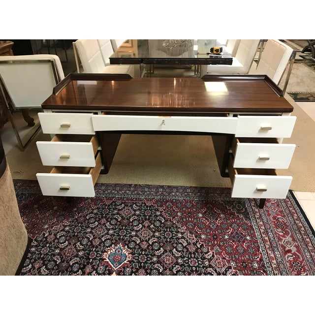 This vanity speaks to the juxtaposition of rubbed lacquer and exotic veneer, a glamorous style of modernism in and around...