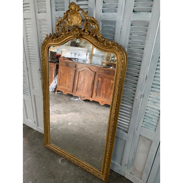 Beautiful Louis Philippe period mirror with original frame and original glass. The frame maintains a tall, rectangular...