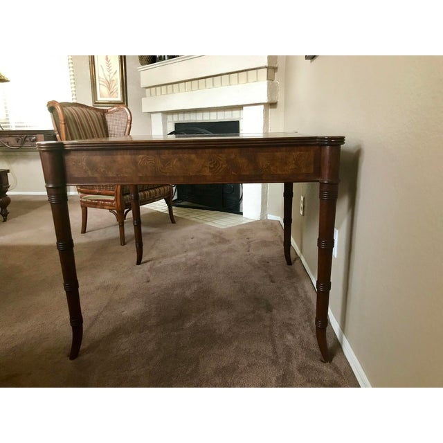 Ethan Allen game table with a inlaid design on the lift-off top with storage in the center for all your game pieces. This...