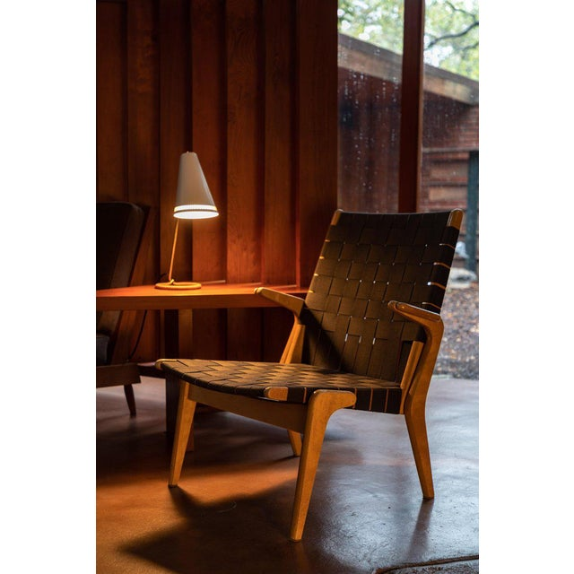 Rare 1950s Colette lounge chair by Ilmari Tapiovaara. Executed in a birch frame with black fabric straps. Originally...