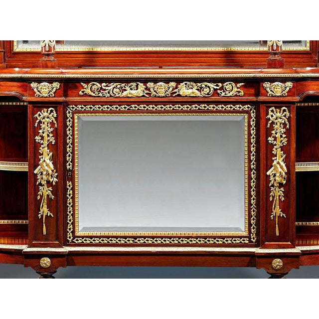 A splendid French Louis XVI style mahogany sideboard lavishly adorned with doré bronze mounts of the highest...