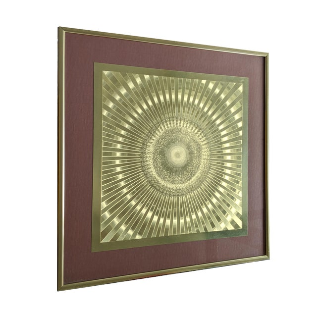 Framed Optic Wall Art . Made of various shades of gold foil to give it an optic illusion effect. Nice brass frame and...