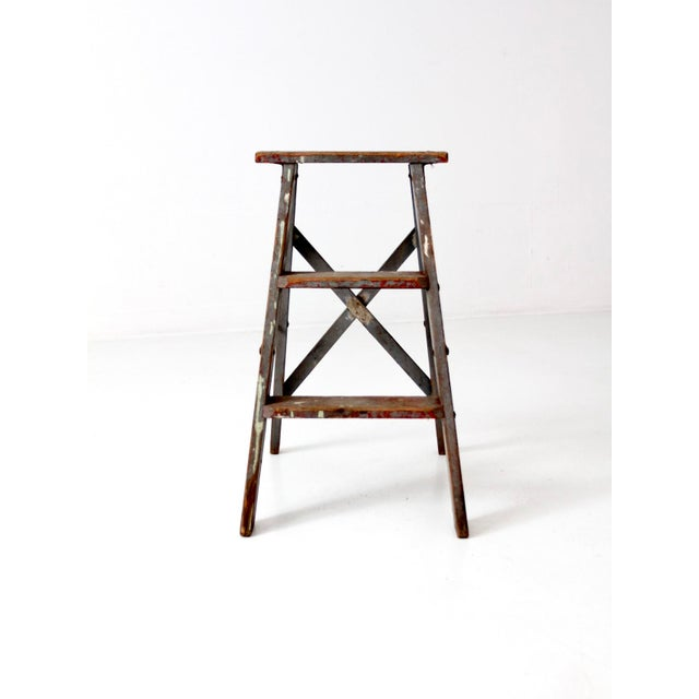 This is a vintage wooden step ladder. The rustic country ladder features a beautiful worn slate gray paint tone with...