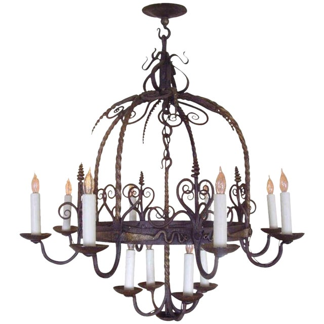 Unusual Provincial Wrought Iron 12-Light Chandelier For Sale