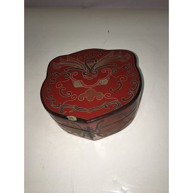 A beautiful old small Chinese red lacquer box in decent except for a nick on top edge. Beautiful gold and black decorations.
