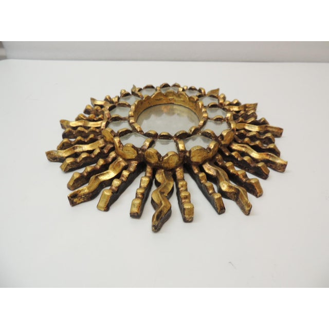 """Vintage Small Gold Leaf on Wood Oval Sunburst Peruvian Mirror Hanging hook in the back Size: 11"""" W x 12"""" H x 0.5"""" D"""