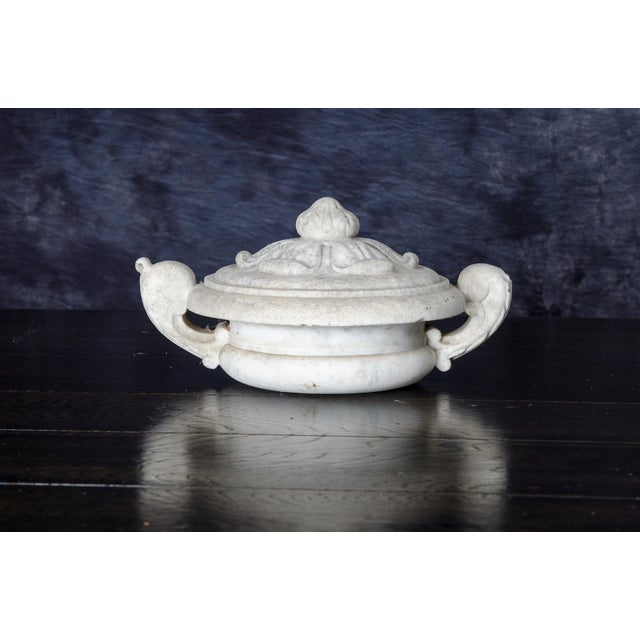 Hand Carved in Carrera Marble this beautiful architectural element is believed to have been a finial at the beginning of...