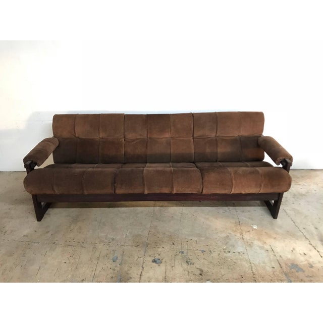 Brazilian rosewood and brown suede sofa designed by Percival Lafer. This item includes restricted materials and can not be...
