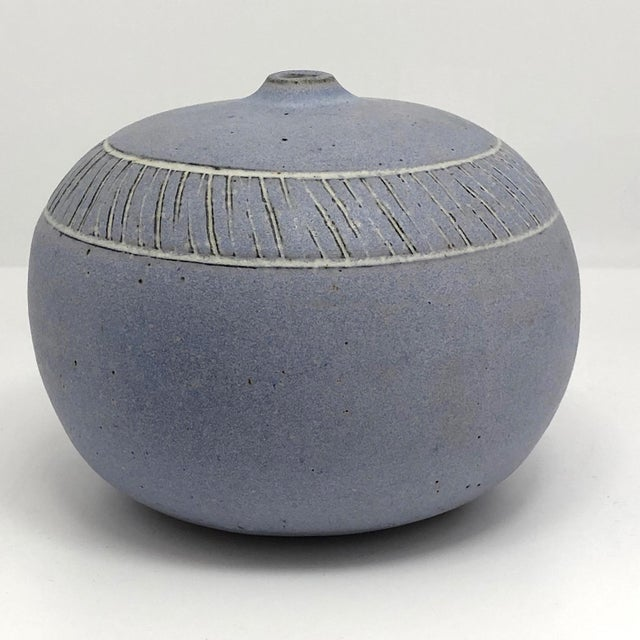 A big, beautiful weed vase, with a nice fat, round body, lovely pale purple glaze, and banded sgraphitto (incised)...