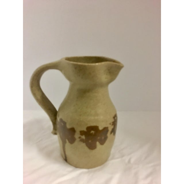 Vintage Japanese ceramic pitcher with a brown trim design, stamped at bottom.