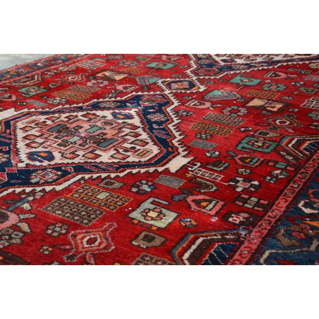 This is an amazing large scale vintage hand woven Persian Hamadan runner with 4 medallions. Color pallet is primarily red...