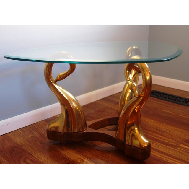 Hollywood Regency Style Brass Swan & Glass Cocktail Table. Solid walnut wood base. Brass swan details. Thick beveled glass...