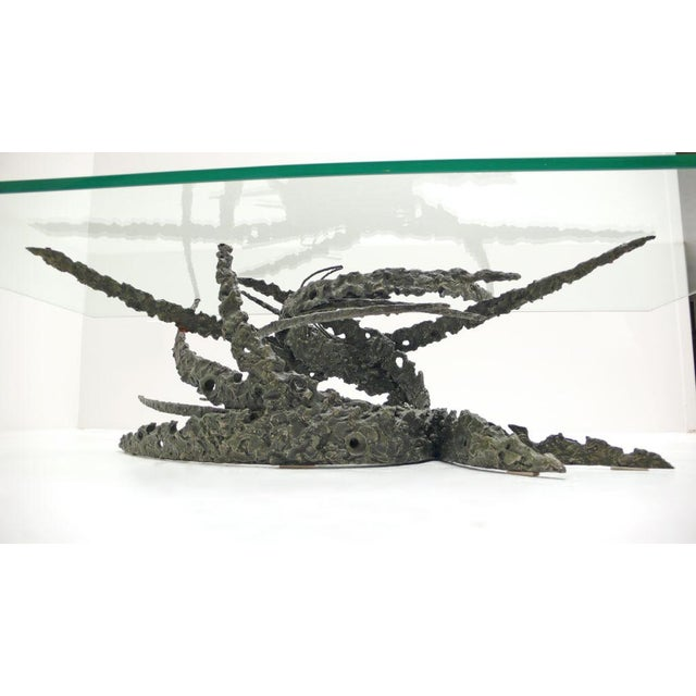 "Torch cut bronze base and glass top coffee table by California artist Daniel Gluck. This table was called the ""swirl""..."