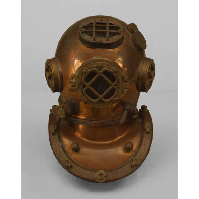 Early 20th American copper and brass model of a diver's helmet mounted on a wood base. 1/2 Scale model