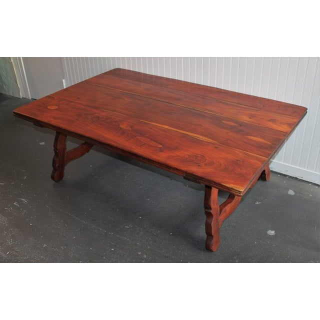 The heavy walnut Spanish style coffee table is in great condition. The construction is dovetailed base and early wood...