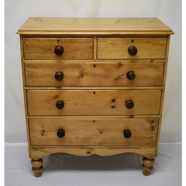 This is a lovely, completely original, mid-Victorian English pine chest of two short over three long graduated, delicately...