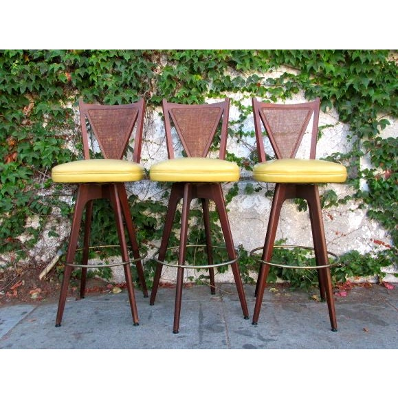 These Mid-Century wicker back bar stools have awesome yellow vinyl seats! The wicker has no holes and the vinyl has no...