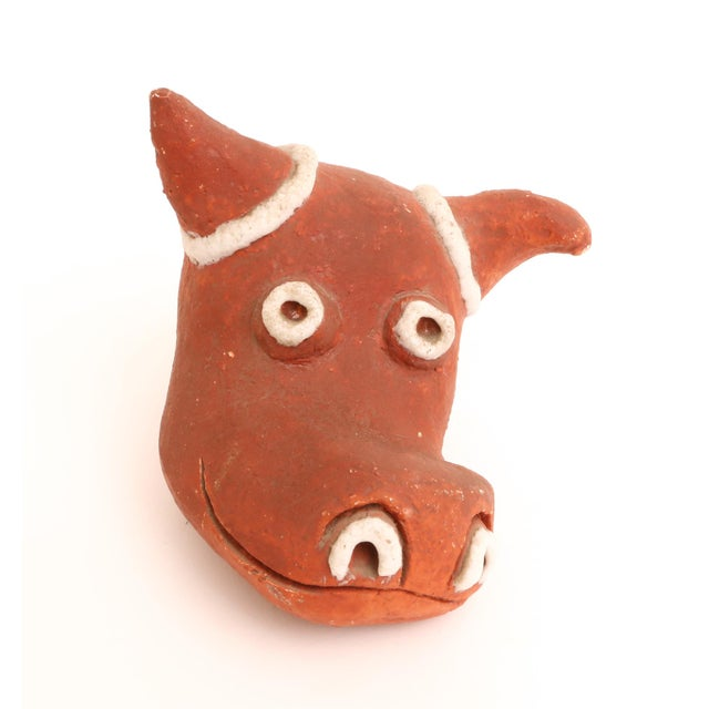 A handmade mid-Century pottery bull figure. Excellent pieces for any mid-century pottery collection. Signed in the bottom.