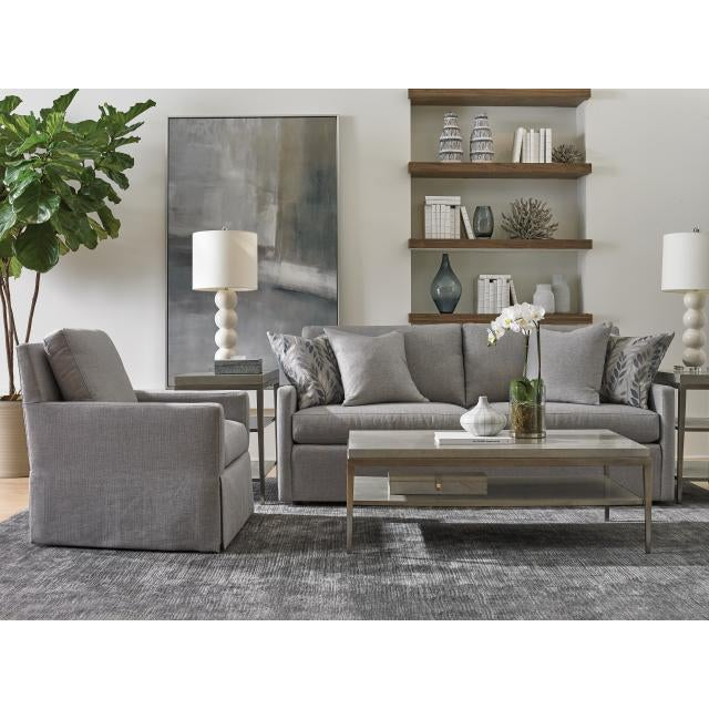 The Lund Coffee Table The Lund Cocktail Table is a handsome combination of metal framing in a white bronze finish with a...