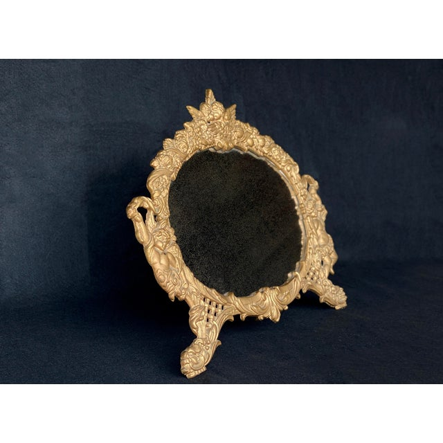 A French Rococo Gilded Brass Cherub Motif Table Mirror, c. Mid 20th Century. This Table Mirror would look exceptional...