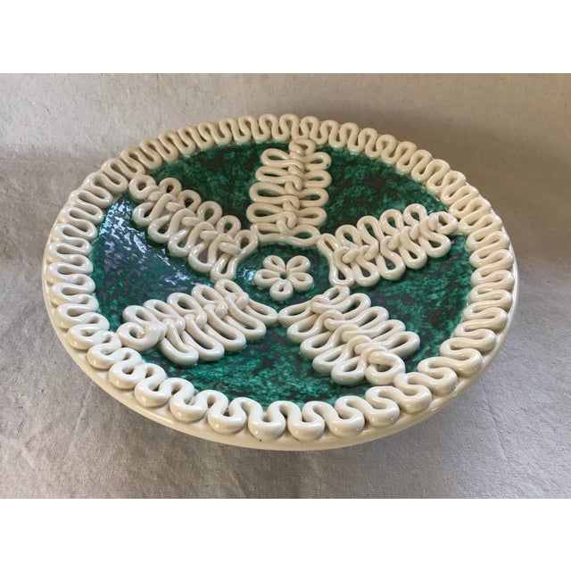 This charming piece is easily mistaken for a work of mid century Italian pottery, but is a rare and older French work with...