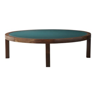 Round coffee table in rosewood with green under-painted glass top For Sale
