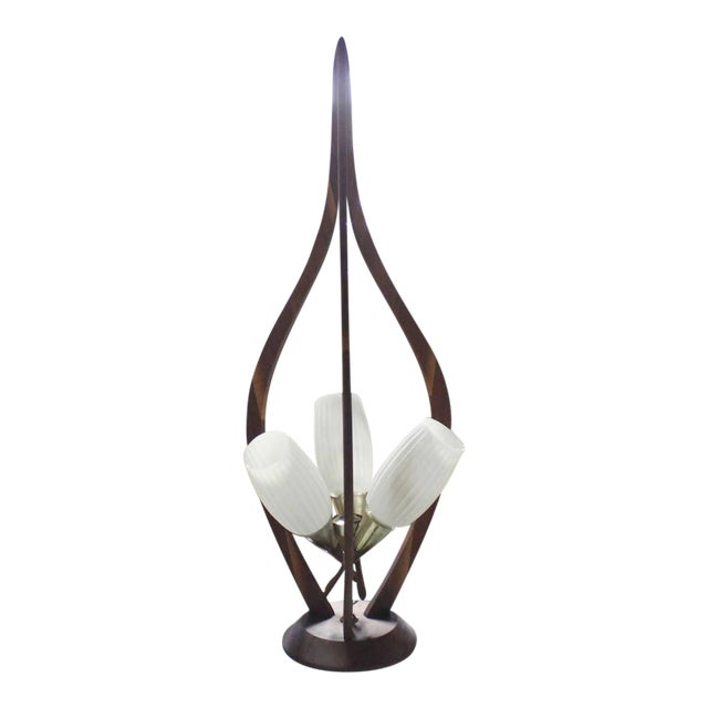 Very nice sculptural Danish mid century modern table lamp. Excellent vintage condition. The fixture looks suspended from...
