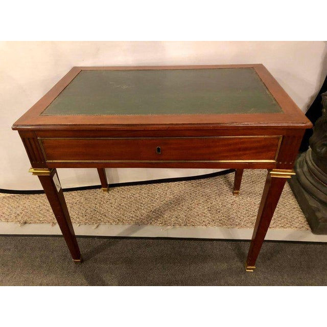 An early Louis XVI Style Leather Top Desk With Pull Out Sides And Bronze Mounts with a single center drawer Stamped...