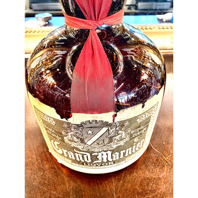 French Grand Marnier specimen dummy bottle. Retains original label, ribbon, and wax sealed top. This bottle would be...