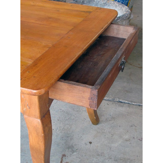 A Handsome, Rustic and Sturdy French Country Cherry Wood Farm Table With Drawer and Slide For Sale - Image 4 of 7
