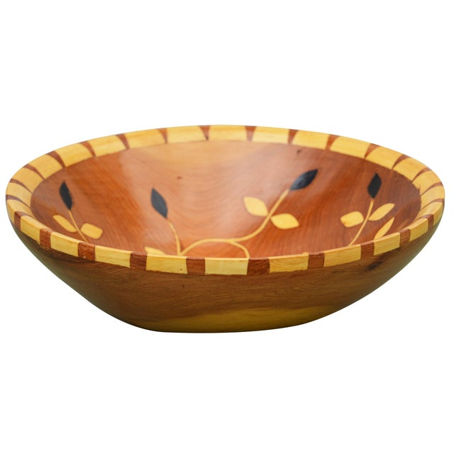 Handcrafted wood bowl carved from argan wood by the Berbers in sub-Saharan Morocco. Ornate inlay and intricate pattern.