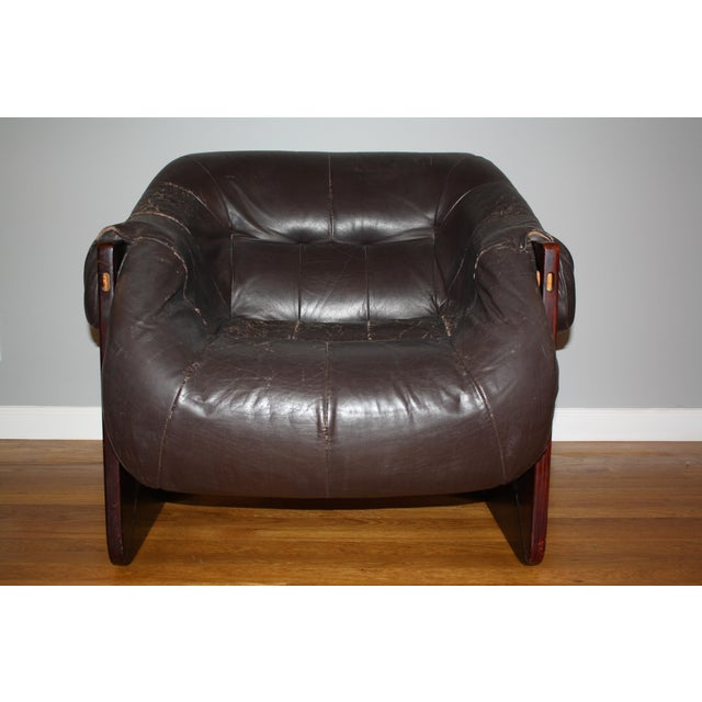 Mid-century modern lounge chair designed by Percival Lafer with rosewood and original vintage dark chocolate leather....