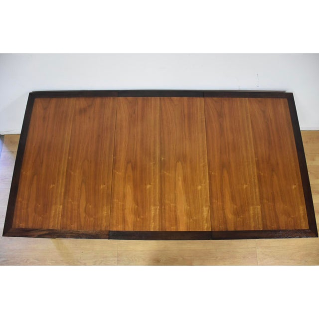 """A wonderful contrasting ebonized mahogany border and walnut top parsons dining table with a single 24"""" leaf designed by..."""