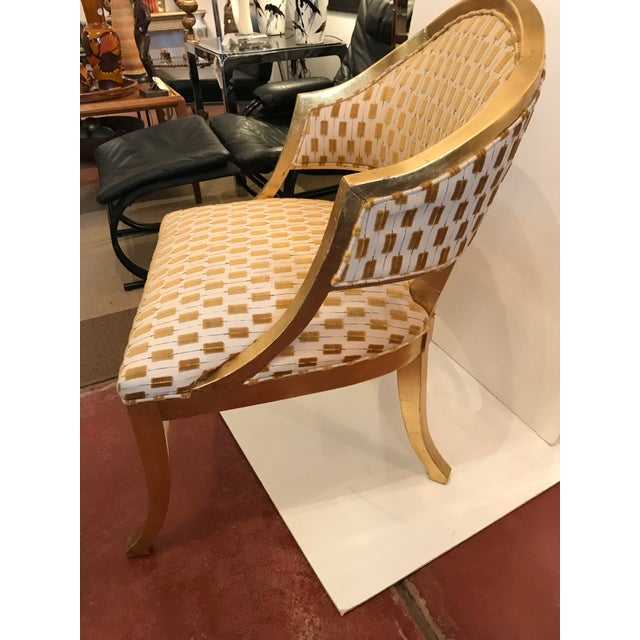"""Century Furniture's """"Amelia"""" chair in gold leaf with minimal wear to frame, and cream-cotton and velvet gold upholstery in..."""