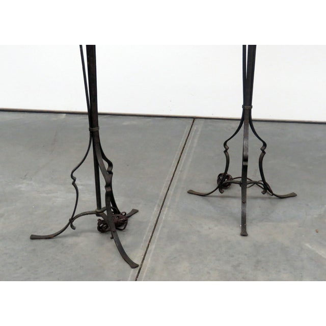 Pair of antique wrought iron 6 light floor lamps.